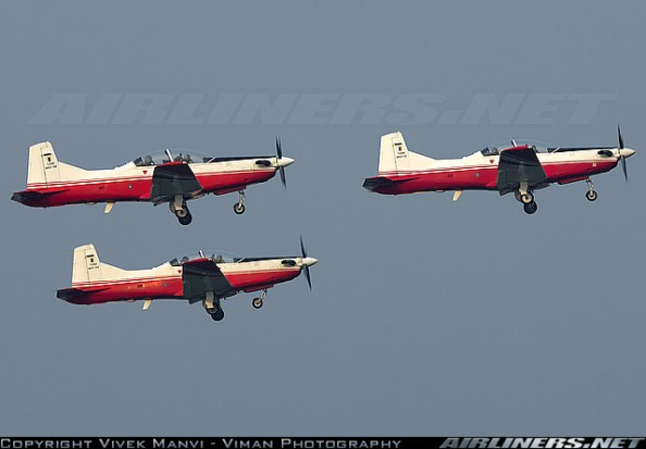 A trio of TUDM Pilatus PC-7 trainer aircraft take-off in a formation from SZB. Aug 31 2015